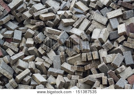 Closeup of a pile of unsorted paving blocks during the reconstruction