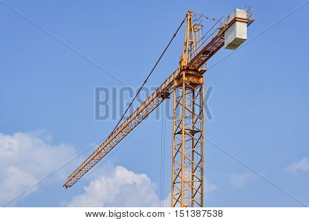 Detail of a construction site with crane and the clear sky