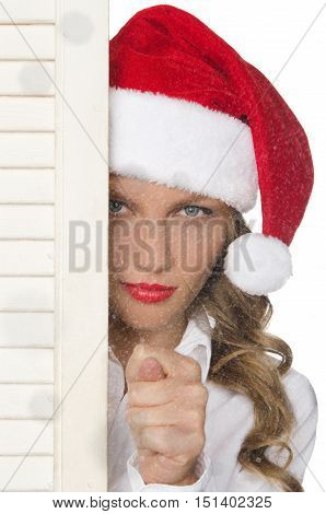 offended woman in Santa hat with snowflakes isolated on white