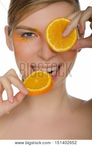smiling woman with orange isolated on white