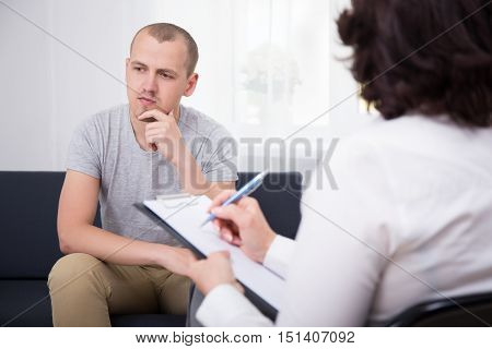 Portrait Of Happy Young Man At Interview In Office