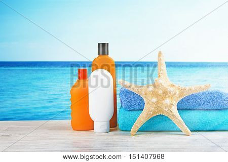 Sun protection set on sea and sky background