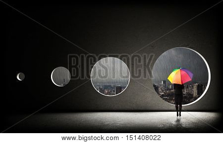 standing woman with umbrella and bad weather
