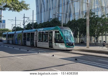 Barcelona, Spain - 25 September 2016: Tram Transport in Barcelona. Tram line T4, part of Trambesos network, at a stop in the Forum area.