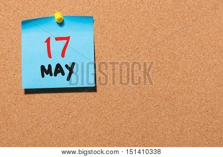 May 17th. Day 17 of month, calendar on cork notice board, business background. Spring time, empty space for text.