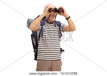 Mature male hiker looking through binoculars isolated on white background