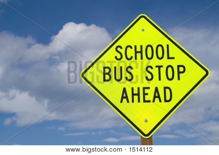 School Bus Stop Ahead Sign At Right