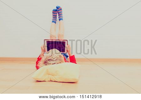 little boy looking at touch pad, home learning
