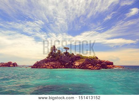 Tropical island at sea, travel and vacation concept
