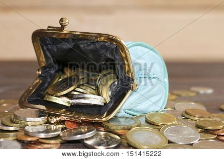 Purse for coins. Open wallet with coins.