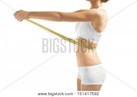 Woman with measure tape, isolated on white
