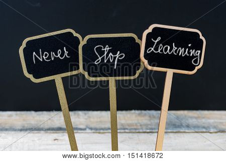 Motivational Message Never Stop Learning Written With Chalk