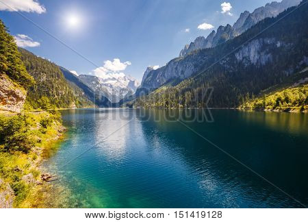 Great azure alpine lake Vorderer Gosausee. Picturesque and gorgeous morning scene. Salzkammergut is a famous resort area located in the Gosau Valley in Upper Austria. Dachstein glacier. Beauty world.