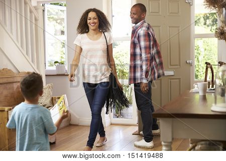 Father Opens Front Door For Mother Returning Home From Work