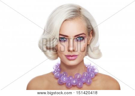 Portrait of young beautiful blonde woman with stylish make-up and hairdo and fancy glass necklace over white background