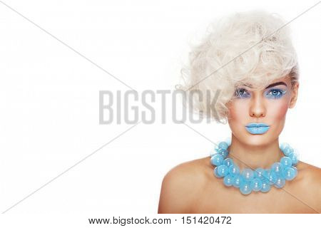 Portrait of young beautiful blonde woman with stylish make-up and hairdo and fancy glass necklace over white background, copy space