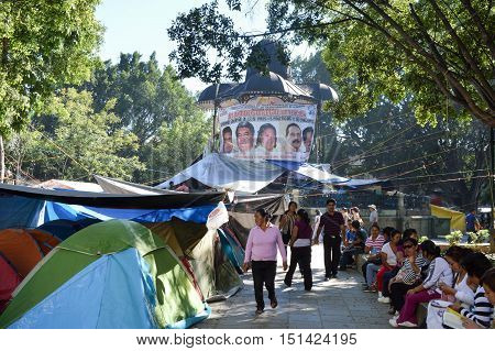 Oaxaca Mexico - November 16 2014: Teachers protest on Zocalo square in the city of Oaxaca tents are seen everywhere in Oaxaca Mexico.