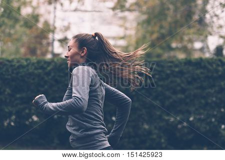 poster of Woman running. Female runner jogging, training for marathon. Fit girl fitness athlete model exercising outdoor.