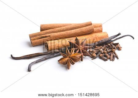 Vanilla, cinnamon, clove and anise star isolated on white background.