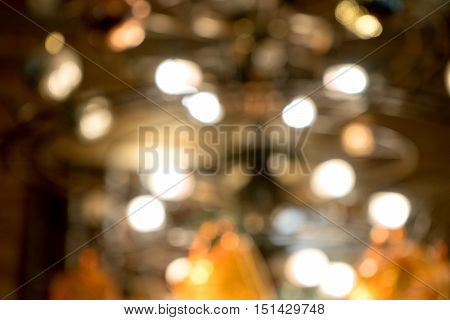 blur light chandelier in coffee shop  background