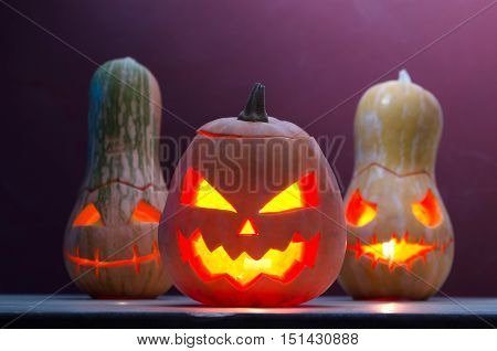 Several Smiling Pumpkins With Candles, Halloween.