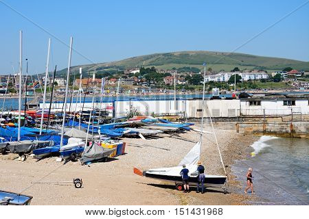 SWANAGE, UNITED KINGDOM - JULY 19, 2016 - Dinghies moored on the beach with the town to the rear Swanage Dorset England UK Western Europe, July 19, 2016.