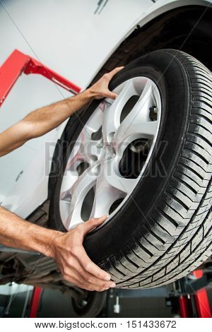 Close-up of a Mechanic Changing a Car Tire