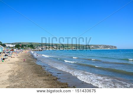 SWANAGE, UNITED KINGDOM - JULY 19, 2016 - View along the beach towards the town and cliffs Swanage Dorset England UK Western Europe, July 19, 2016.