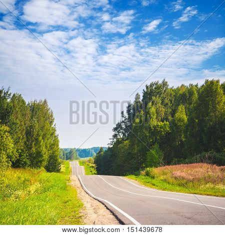 Blue Cloudy Sky And Empty Rural Highway