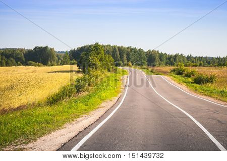 Turning Rural Highway Under Blue Sky