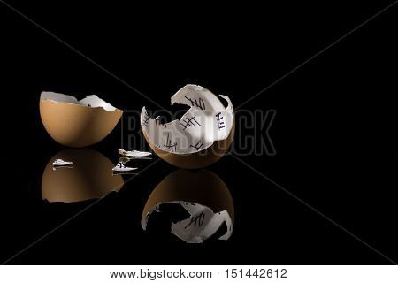 cracked egg shell with countdown on black background