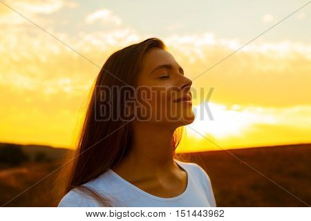Praying / Meditating Woman at Dawn / Sunset