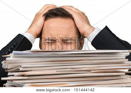 Closeup of an Exhausted Employee Behind Stack of Folders