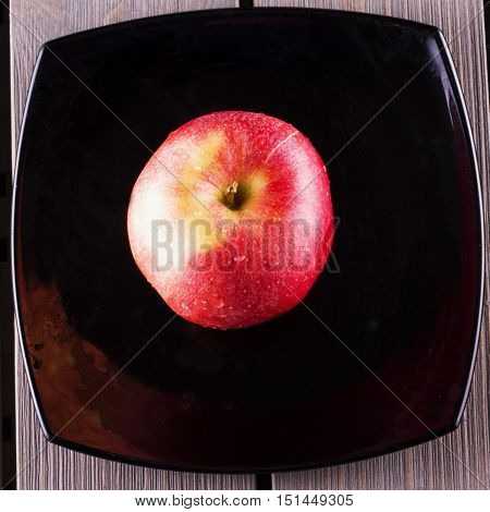 Apple Over Black Plate
