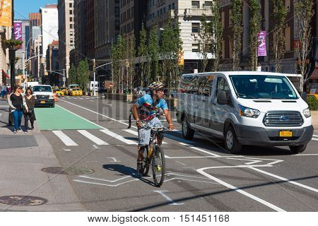 New York NY US -- October 11 2016. A cyclist rides his bike near a van in the bike lane in lowewr Manhattan. Editorial Use Only.