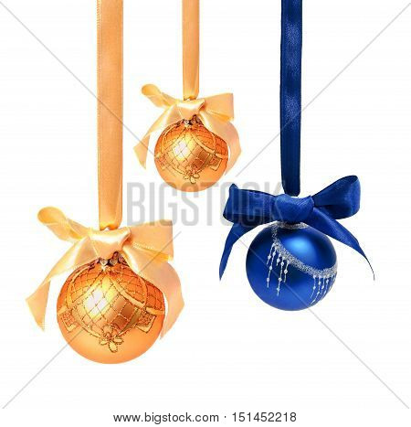 Hunging golden ahd blue christmas balls isolated on a white background