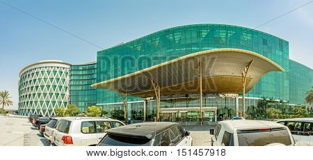 DUBAI, UAE - OCTOBER 12, 2016: The Meydan Hotel  designed in the shape of a wave in motion with a green glass facade, boasts spectacular views and enjoys a majestic position overlooking the racecourse