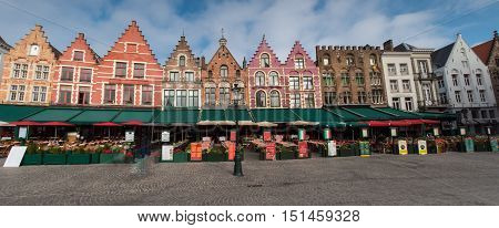 street view in Brugge of historic houses during autumn time