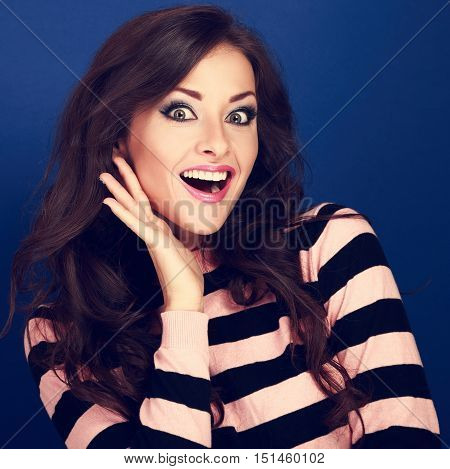 Surprised Makeup Woman With Opened Mouth And Big Eyes Holding Hand The Face And Looking Happy On Blu