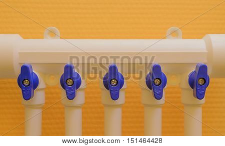 Polypropylene pipe to the collector on a background of yellow wall