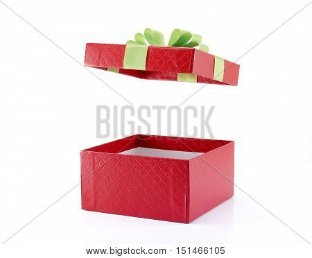 open red gift box with green ribbon isolated on white background