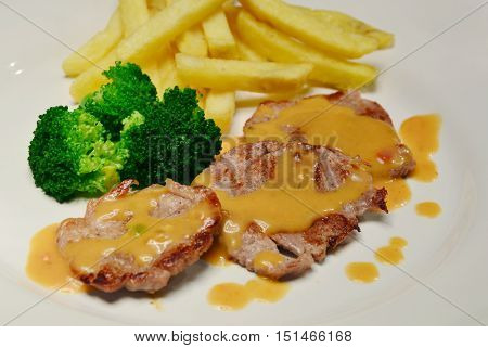 Pork Tenderloin menu with Champignon sause and French fries