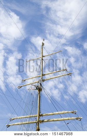 Mast of a sailing ship in cloudy skay