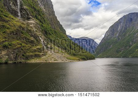 This is Naeroyfjord (an offshoot of the Sognefjord) which is the narrowest fjord in Norway listed as a UNESCO World Heritage Site.