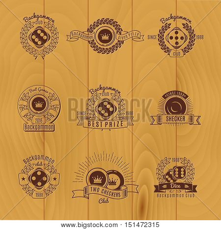 Backgammon monochrome emblems with components of game laurel leaves and ribbons on wooden background isolated vector illustration