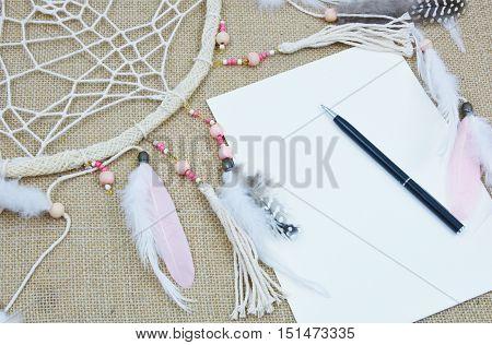 Dream it. Do it . Dream catcher with paper and pen. (soft focus,lens blur)