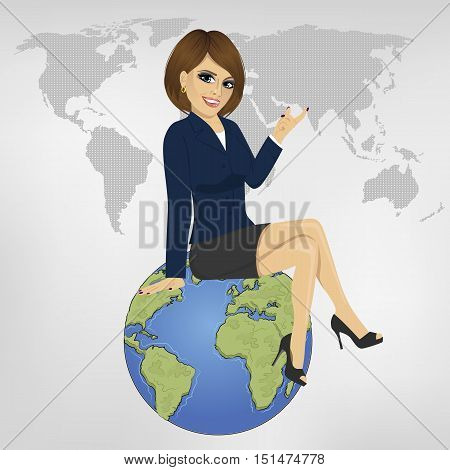 young beautiful businesswoman sitting on a globe showing something