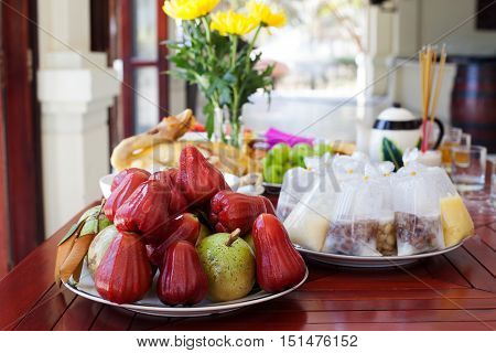 Traditional, ceremonial Asian food, fruits desserts, duck, rice on the table