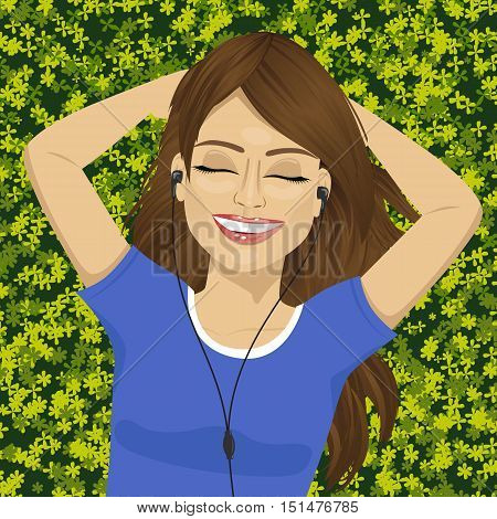 young woman with eyes closed listening music with smartphone lying on grass