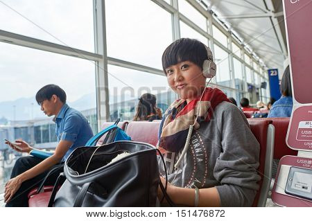 HONG KONG - NOVEMBER 03, 2015: indoor portrait of a woman at Hong Kong Airport. Hong Kong International Airport is the main airport in Hong Kong. It is located on the island of Chek Lap Kok.